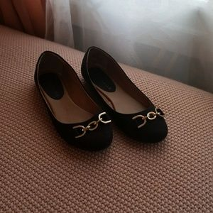 Black flats with gold detail
